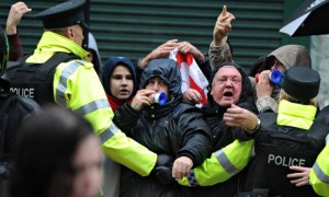 Loyalist protesters held back by police in Belfast